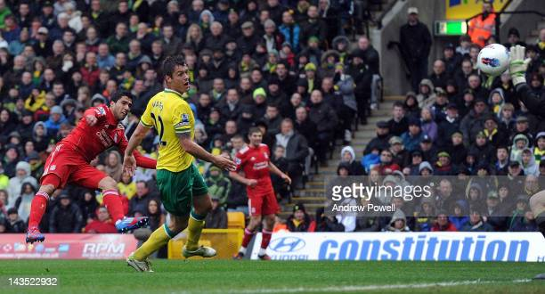 Luis Suarez of Liverpool scores the opening goal during the Barclays Premier League match between Norwich City and Liverpool at Carrow Road on April...