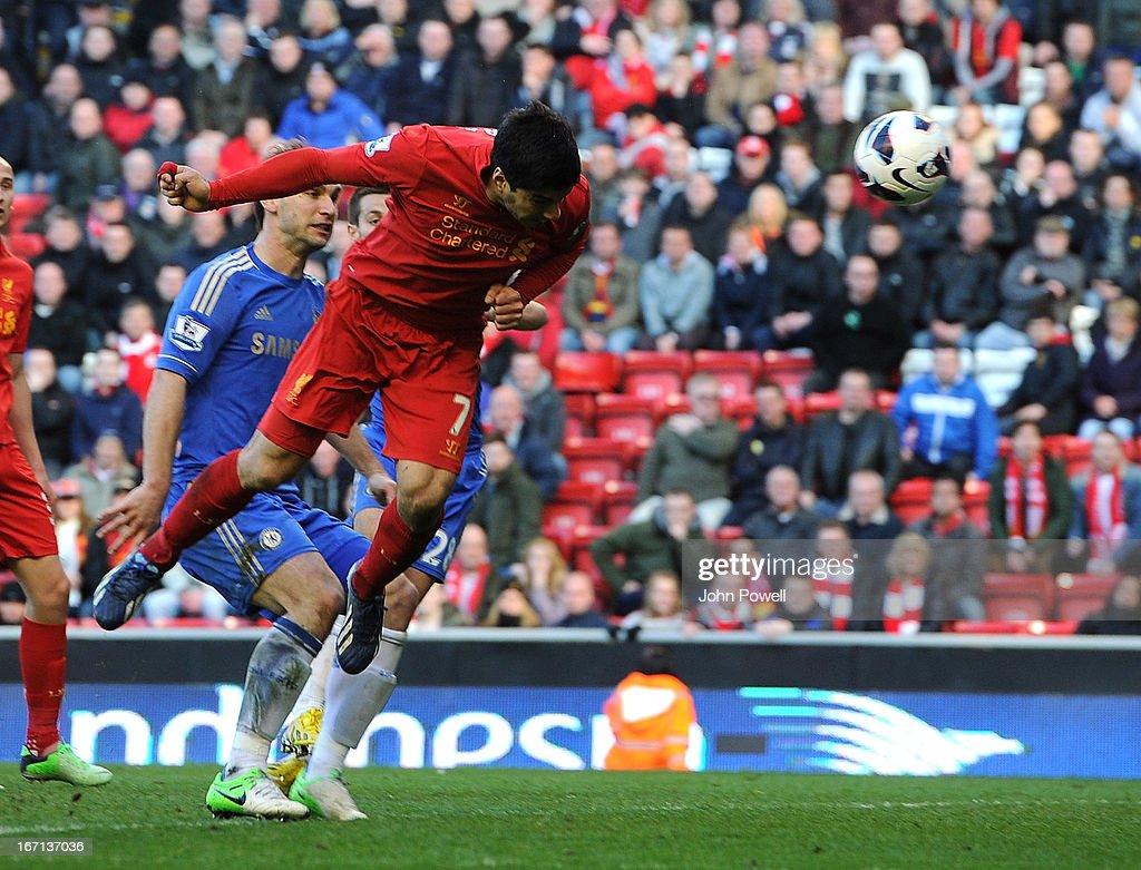 Luis Suarez of Liverpool scores the second goal for Liverpool to make it 2-2 during the Barclays Premier League match between Liverpool and Chelsea at Anfield on April 21, 2013 in Liverpool, England.