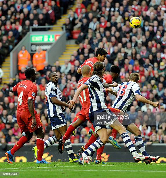 Luis Suarez of Liverpool scores the third goal during the Barclays Premier League match between Liverpool and West Bromwich Albion at Anfield on...