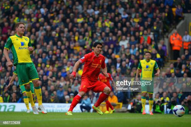 Luis Suarez of Liverpool scores their second goal during the Barclays Premier League match between Norwich City and Liverpool at Carrow Road on April...