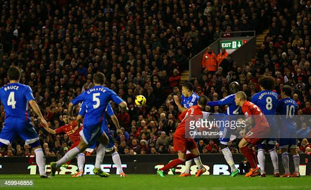 Luis Suarez of Liverpool scores their second goal from a free kick during the Barclays Premier League match between Liverpool and Hull City at...