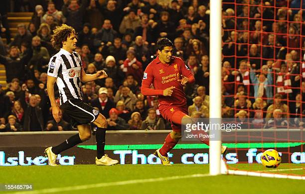 Luis Suarez of Liverpool scores to make it 11 during the Barclays Premier League match between Liverpool and Newcastle United at Anfield on November...