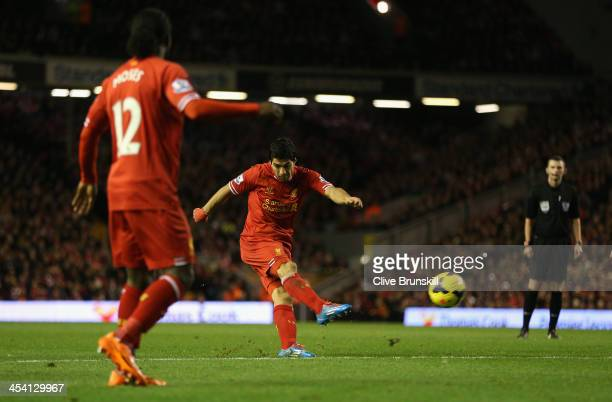 Luis Suarez of Liverpool shoots at goal prior to Joey O'Brien of West Ham United's own goal during the Barclays Premier League match between...