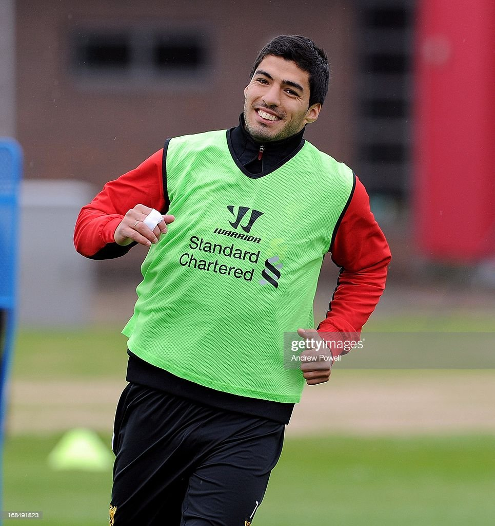 Luis Suarez of Liverpool smiles during a training session at Melwood Training Ground on May 10, 2013 in Liverpool, England.