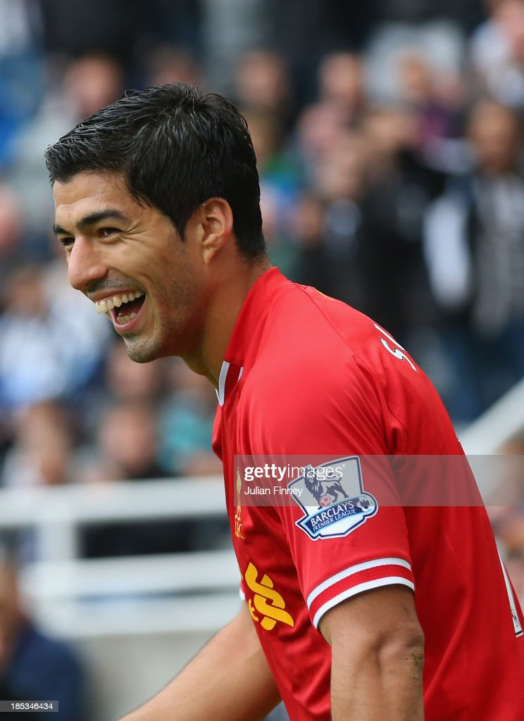 Luis Suarez of Liverpool smiles during the Barclays Premier League match between Newcastle United and Liverpool at St James' Park on October 19, 2013 in Newcastle upon Tyne, England.