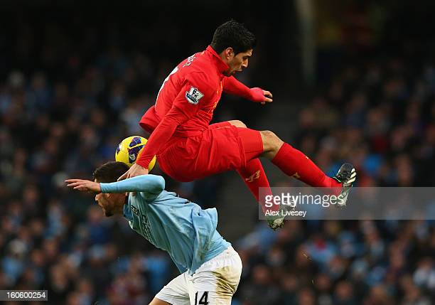 Luis Suarez of Liverpool tangles with Javi Garcia of Manchester City during the Barclays Premier League match between Manchester City and Liverpool...