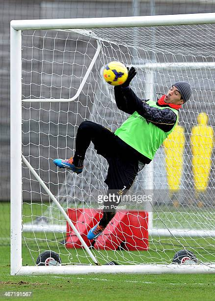 Luis Suarez of Liverpool trys his hand at goalkeeping during a training session at Melwood Training Ground on February 6 2014 in Liverpool England