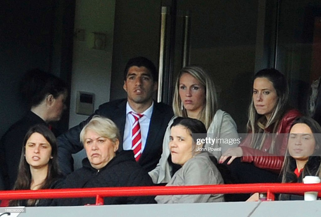 Luis Suarez of Liverpool watches the game from a box during the Barclays Premier League match between Liverpool and Everton at Anfield on May 5, 2013 in Liverpool, England.