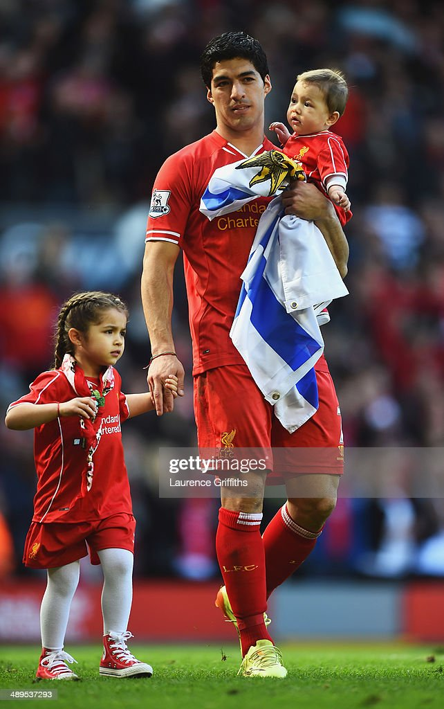 Luis Suarez of Liverpool with his children Delfina and Benjamin after the Barclays Premier League match between Liverpool and Newcastle United at Anfield on May 11, 2014 in Liverpool, England. Liverpool finish as runners-up in the Premier League.