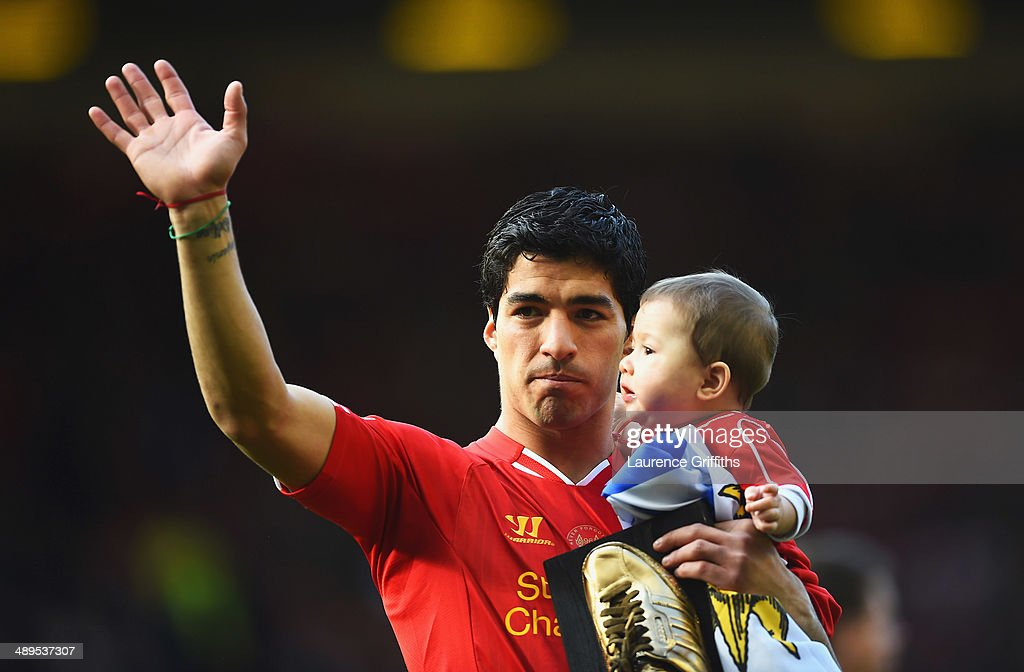 Luis Suarez of Liverpool with his son Benjamin after the Barclays Premier League match between Liverpool and Newcastle United at Anfield on May 11, 2014 in Liverpool, England. Liverpool finish as runners-up in the Premier League.