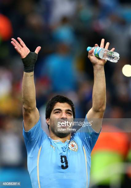 Luis Suarez of Uruguay acknowledges the fans after defeating England 21 during the 2014 FIFA World Cup Brazil Group D match between Uruguay and...