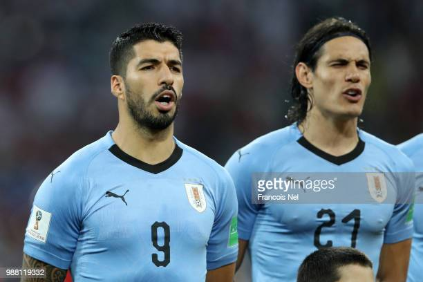 Luis Suarez of Uruguay and Edinson Cavani of Uruguay sing the national anthem prior to the 2018 FIFA World Cup Russia Round of 16 match between...