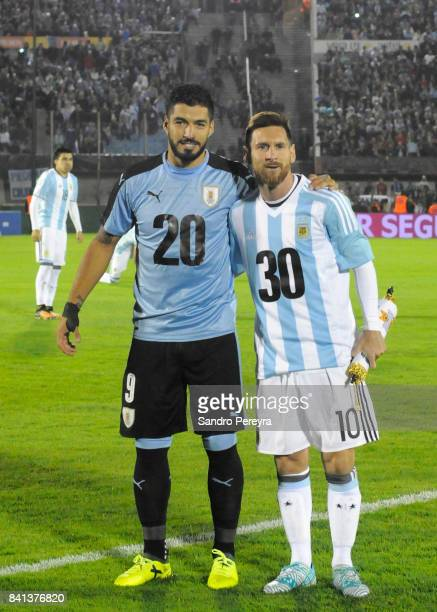 Luis Suarez of Uruguay and Lionel Messi of Argentina pose with the jerserys 20 and 30 before a match between Uruguay and Argentina as part of FIFA...