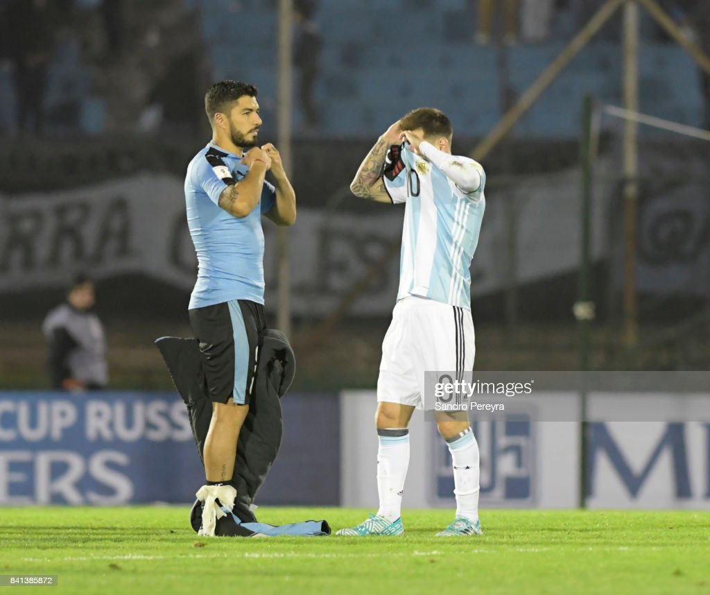 Luis Suarez of Uruguay and Lionel Messi of Argentina swap jerseys after a match between Uruguay and Argentina as part of FIFA 2018 World Cup Qualifiers at Centenario Stadium on August 31, 2017 in Montevideo, Uruguay.