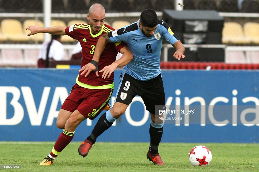 Luis Suarez of Uruguay and Mikel Villanueva of Venezuela fight for the ball during a match between Venezuela and Uruguay as part of FIFA 2018 World Cup Qualifiers at Pueblo Nuevo Stadium on October 05, 2017 in San Cristobal, Venezuela.