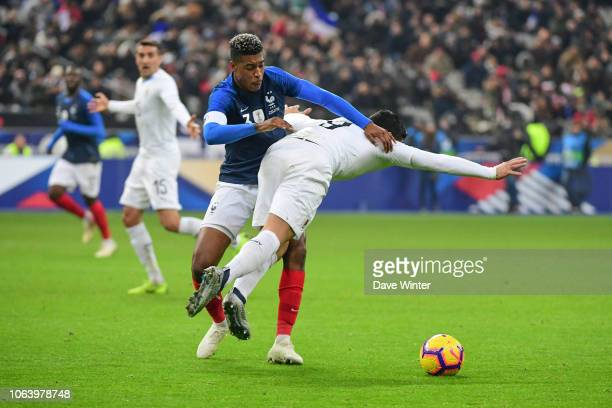 Luis Suarez of Uruguay and Presnel Kimpembe of France during the International Friendly match between France and Uruguay at Stade de France on...