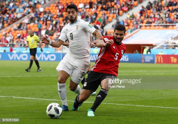 Luis Suarez of Uruguay and Sam Morsy of Egypt battle for the ball during the 2018 FIFA World Cup Russia group A match between Egypt and Uruguay at...