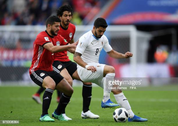 Luis Suarez of Uruguay battles for the ball with Sam Morsy and Ahmed Hegazy of Egypt during the 2018 FIFA World Cup Russia group A match between...