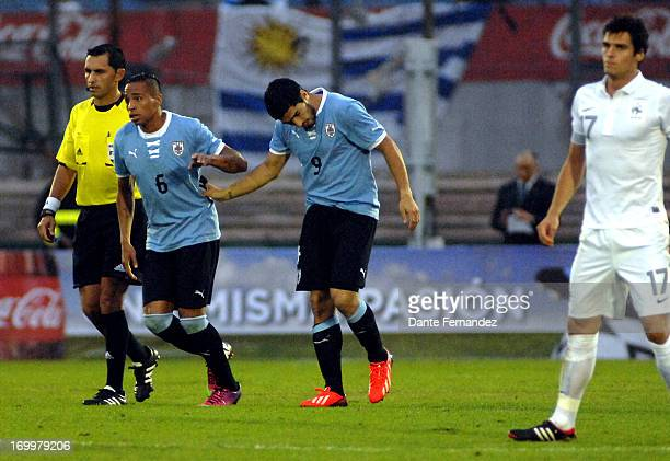 Luis Suarez of Uruguay celebrates a scored goal during a match between Uruguay and France as part of an International Friendly match at Centenario...