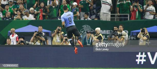 Luis Suarez of Uruguay celebrates after a scorimg against Mexico in the first half during the International Friendly match between Mexico and Uruguay...