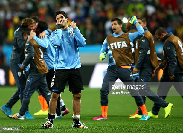 Luis Suarez of Uruguay celebrates after defeating England 21 during the 2014 FIFA World Cup Brazil Group D match between Uruguay and England at Arena...