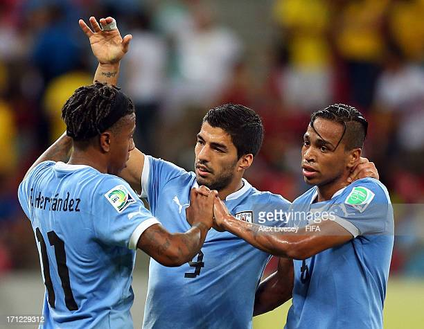 Luis Suarez of Uruguay celebrates after scoring a goal in the 90th minute with Alvaro Pereira and Abel Hernandez during the FIFA Confederations Cup...
