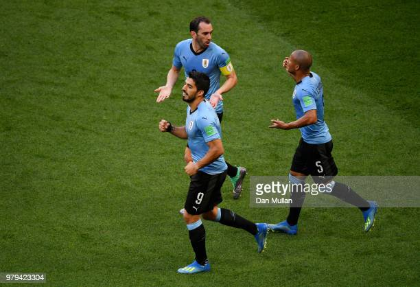 Luis Suarez of Uruguay celebrates after scoring his team's first goal during the 2018 FIFA World Cup Russia group A match between Uruguay and Saudi...