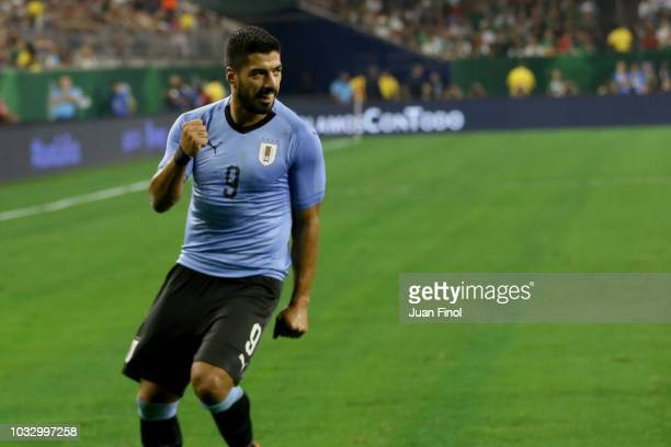 Luis Suarez of Uruguay celebrates after scoring his team's second goal during the International Friendly match between Mexico and Uruguay at NRG...