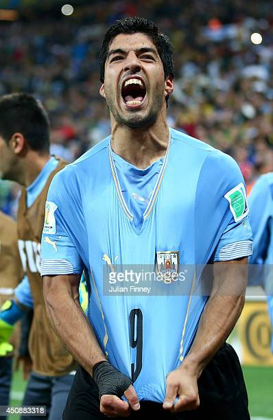 Luis Suarez of Uruguay celebrates after scoring his team's second goal during the 2014 FIFA World Cup Brazil Group D match between Uruguay and...