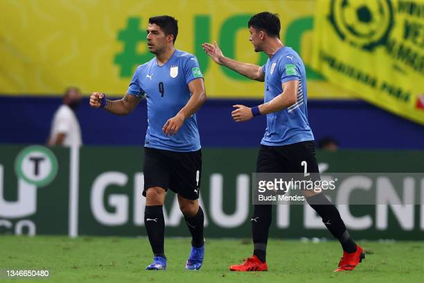 Luis Suarez of Uruguay celebrates after scoring the first goal of his team during a match between Brazil and Uruguay as part of South American...