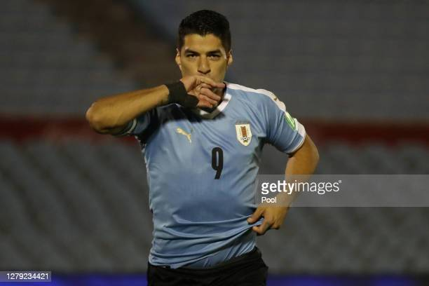 Luis Suarez of Uruguay celebrates after scoring the opening goal of his team during a match between Uruguay and Chile as part of South American...