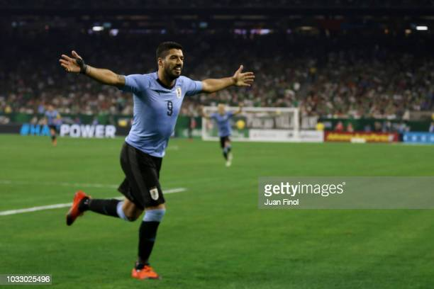 Luis Suarez of Uruguay celebrates his assistance for his team's fourth goal during the International Friendly match between Mexico and Uruguay at NRG...