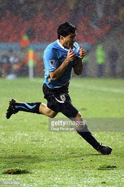 Luis Suarez of Uruguay celebrates scoring his second goal during the 2010 FIFA World Cup South Africa Round of Sixteen match between Uruguay and...