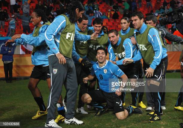 Luis Suarez of Uruguay celebrates scoring his second goal with team mates during the 2010 FIFA World Cup South Africa Round of Sixteen match between...