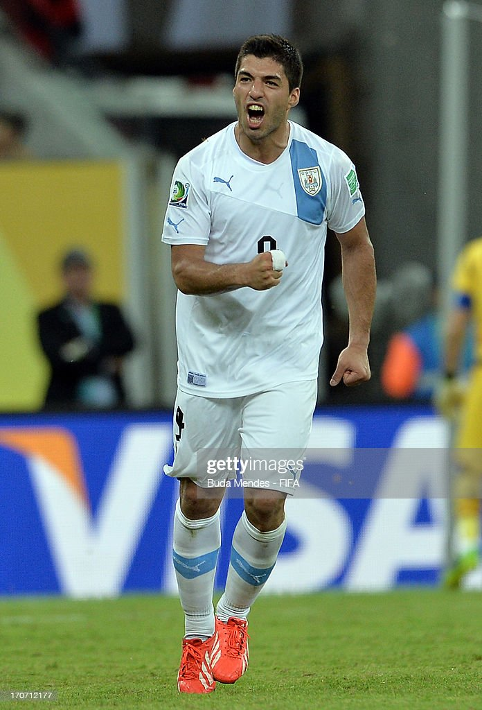 Luis Suarez of Uruguay celebrates scoring his team's first goal during the FIFA Confederations Cup Brazil 2013 Group B match between Spain and Uruguay at the Arena Pernambuco on June 16, 2013 in Recife, Brazil.