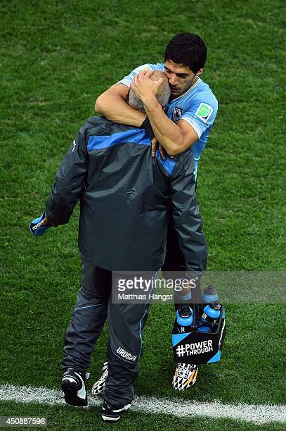 Luis Suarez of Uruguay celebrates scoring his team's first goal during the 2014 FIFA World Cup Brazil Group D match between Uruguay and England at...