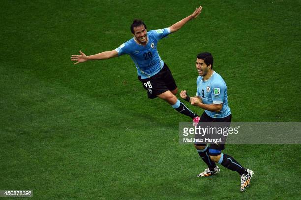 Luis Suarez of Uruguay celebrates scoring his team's first goal with Alvaro Gonzalez during the 2014 FIFA World Cup Brazil Group D match between...