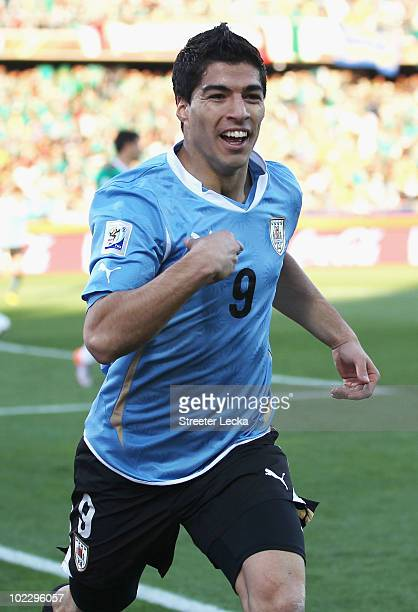 Luis Suarez of Uruguay celebrates scoring the opening goal during the 2010 FIFA World Cup South Africa Group A match between Mexico and Uruguay at...