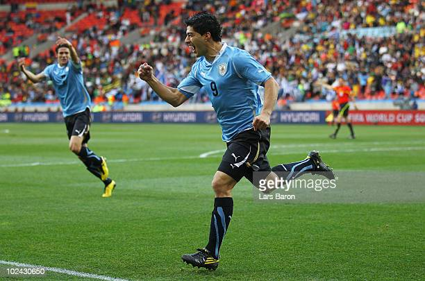 Luis Suarez of Uruguay celebrates scoring the opening goal during the 2010 FIFA World Cup South Africa Round of Sixteen match between Uruguay and...