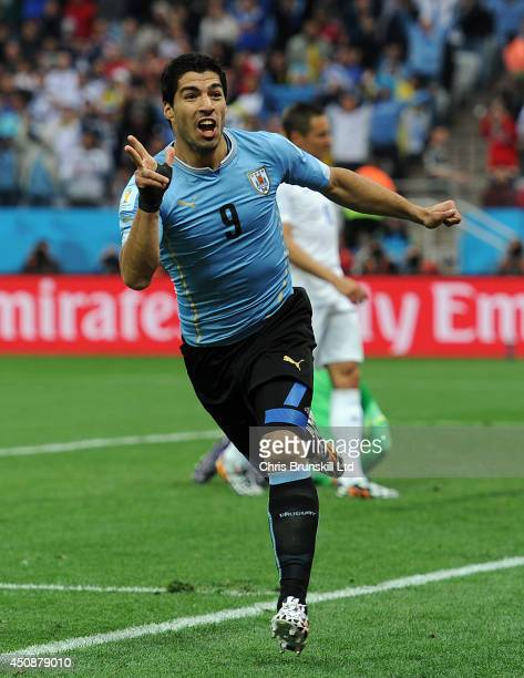 Luis Suarez of Uruguay celebrates scoring the opening goal during the 2014 FIFA World Cup Brazil Group B match between Uruguay and England at Arena...