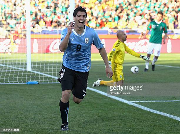 Luis Suarez of Uruguay celebrates scoring the opening goal past Oscar Perez of Mexico during the 2010 FIFA World Cup South Africa Group A match...