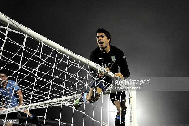 Luis Suarez of Uruguay celebrates victory over Costa Rica during their match as part of the 2010 World Cup Qualifiers at the Centenario Stadium on...