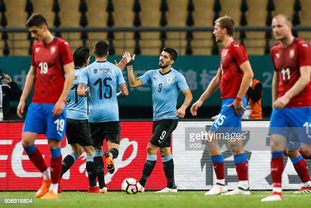 5e6a6d2570c Luis Suarez of Uruguay celebrates with team mates after scoring his team s first  goal with a