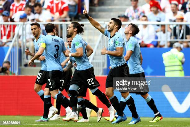 Luis Suarez of Uruguay celebrates with teammate Diego Godin Martin Caceres and Rodrigo Bentancur after scoring his team's first goal during the 2018...