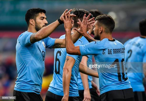 Luis Suarez of Uruguay celebrates with teammate Giorian De Arrascaeta during their China Cup International Football Championship Semifinal match...