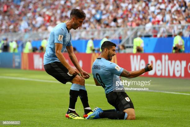 Luis Suarez of Uruguay celebrates with teammate Rodrigo Bentancur after scoring his team's first goal during the 2018 FIFA World Cup Russia group A...