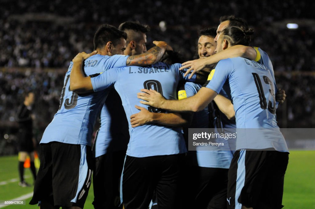 Luis Suarez of Uruguay celebrates with teammates after scoring his team's third goal during a match between Uruguay and Bolivia as part of FIFA 2018 World Cup Qualifiers at Centenario Stadium on October 10, 2017 in Montevideo, Uruguay.