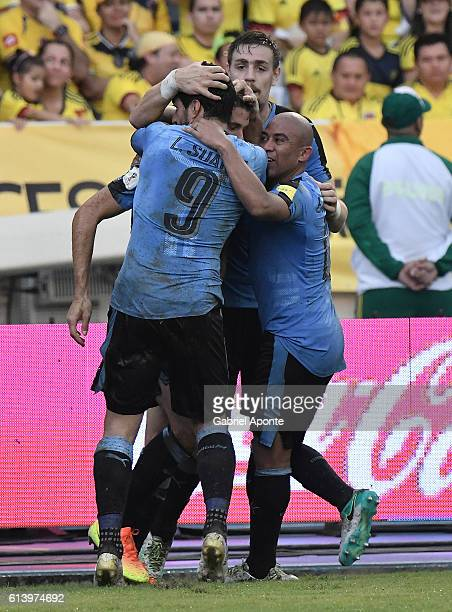 Luis Suarez of Uruguay celebrates with teammates after scoring the second goal of his team during a match between Colombia and Uruguay as part of...