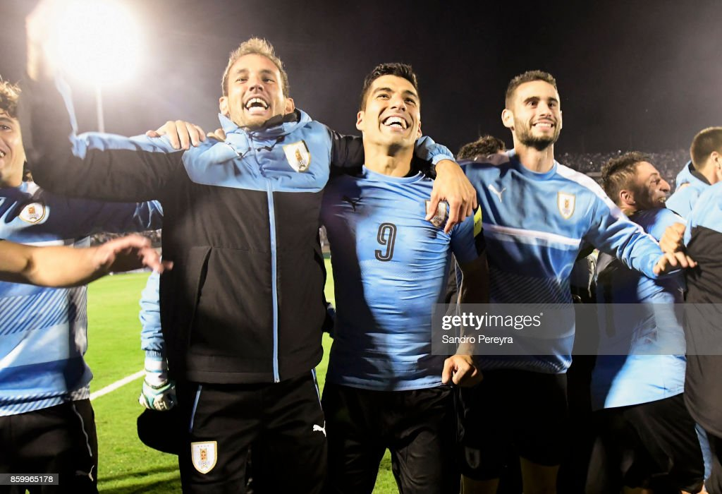 Luis Suarez of Uruguay celebrates with teammates the victory and qualifying to the World Cup after a match between Uruguay and Bolivia as part of FIFA 2018 World Cup Qualifiers at Centenario Stadium on October 10, 2017 in Montevideo, Uruguay.