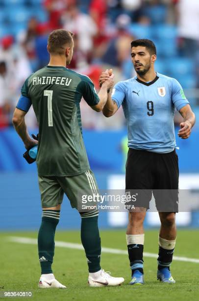 Luis Suarez of Uruguay congratulates Igor Akinfeev of Russia following the 2018 FIFA World Cup Russia group A match between Uruguay and Russia at...